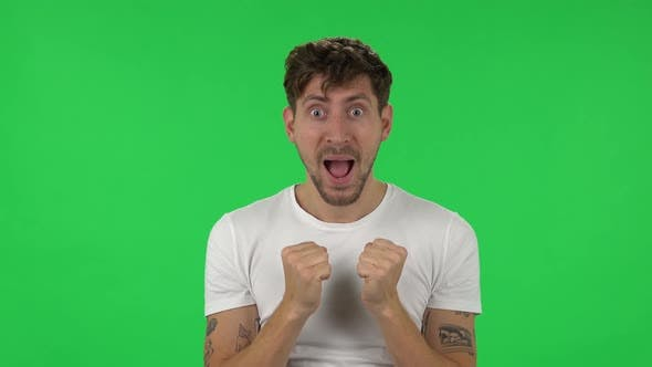 Thumbnail for Portrait of Confident Guy with Shocked Surprised Wow Face Expression Is Rejoicing