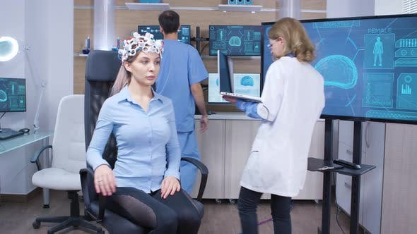 Neuro Science Female Doctor and Her Assistant in Modern Facility