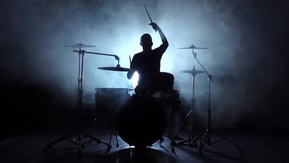 Thumbnail for Energetic Music in the Performance of a Professional Drummer, Black Background, Silhouette, Slow