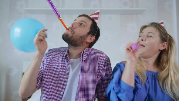 Thumbnail for Parties on Network, Cute Funny Married Couple of Men and Women in Hats with Balls and Pipes Having