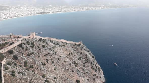 Alanya, Turkey, view of city with tourist area, quay, residential buildings and mountains