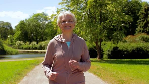 Thumbnail for Senior Woman Running Along Summer Park