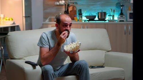 Upset Caucasian Man Watching Sport Match Alone