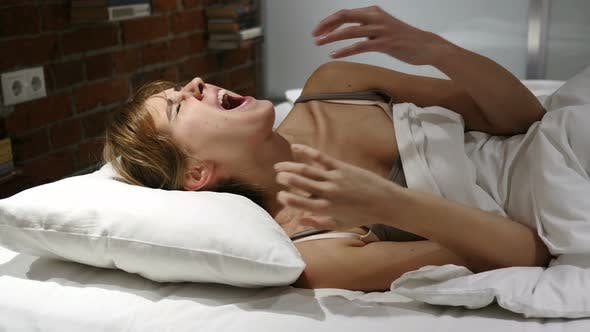 Thumbnail for Frustrated Tense Woman Lying in Bed Screaming in Anger