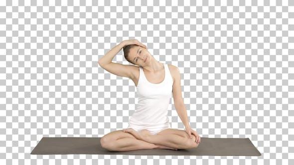 Thumbnail for Peaceful Woman Practising Yoga Sitting in Lotus Pose, Stretching
