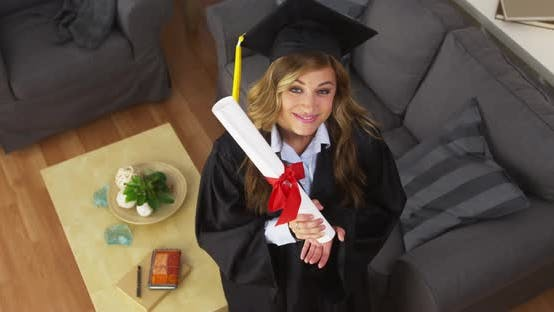 Thumbnail for Female College graduate holding diploma and smiling