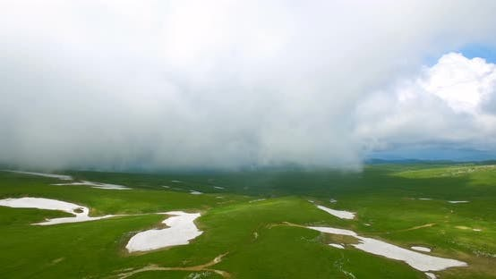 Thumbnail for Aerial View Caucasus Mountains In The Fog In Bad Weather.