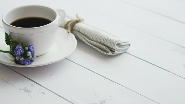 Thumbnail for Black Coffee in White Cup on Bright Wooden Background.