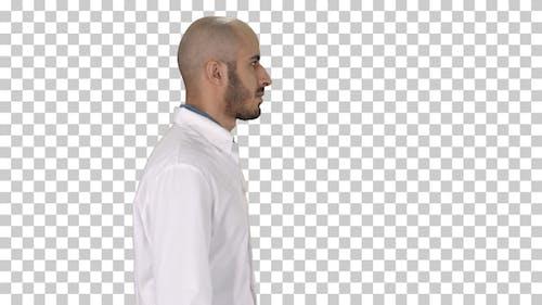Arabian doctor in white robe walking, Alpha Channel