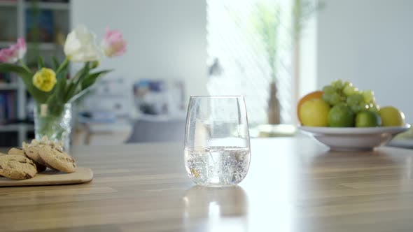 Thumbnail for Hand Taking Glass Of Sparkling Water