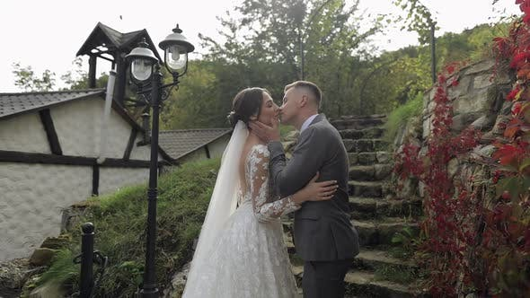 Thumbnail for Lovely Newlyweds Caucasian Bride Embracing Groom in Park Making Kiss Wedding Couple Family Hugging