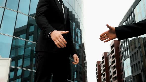 Thumbnail for Business Associates Shaking Hands