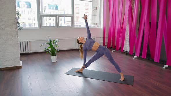 Fit Woman Practicing Yoga in Studio