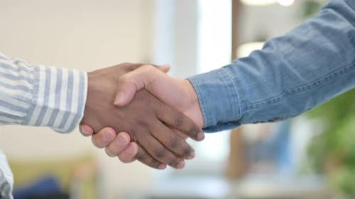 Close Up of Two Man Shaking Hands