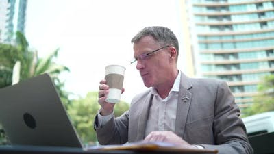 businessman working with data on laptop, concept idea of starting work on a morning in the city