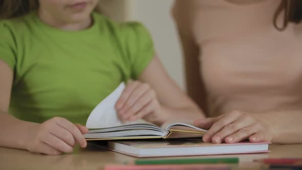 Thumbnail for Mother and Little Daughter Reading Stories in Book Enjoying Leisure Together
