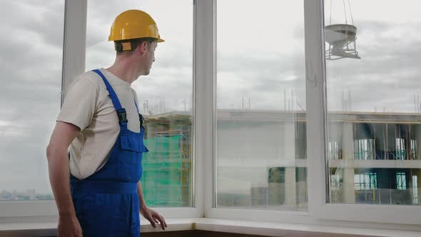 Thumbnail for Serious Confident Worker with Arms Crossed Wearing Protective Helmet. Constructions Site.