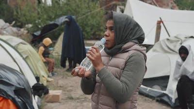 Homeless Girl Drinking Water