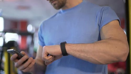Man Checking His Fitness App After Workout to See Progress and Results