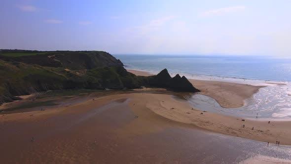 A Flight over a Beach towards Cliffs