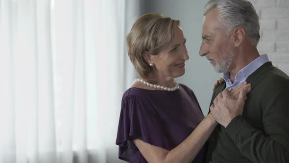 Cover Image for Elderly Couple Dancing and Looking at Each Other, Putting Heads Together, Love