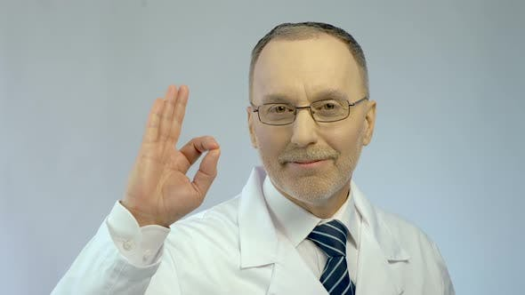 Thumbnail for Male Physician Smiling, Showing OK Gesture, Sure of Successful Treatment Results