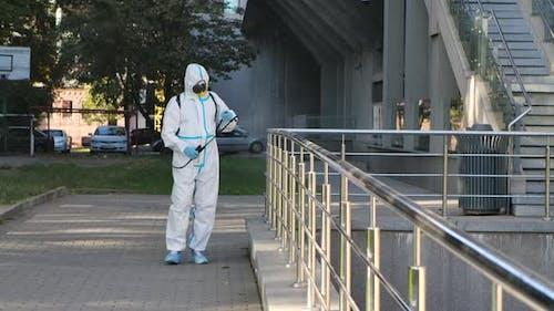 Man Disinfect Handrail Covid-19 Mers. Corona Virus Flu Disinfection. Coronavirus Disinfectant