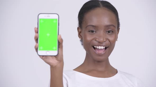 Cover Image for Face of Happy Young Beautiful African Woman Showing Phone