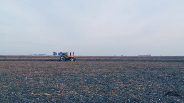Thumbnail for Tractor Plowing the Field at Sunset.