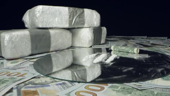 Thumbnail for View of white powdered drugs on table top of money