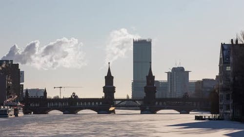 Early morning time lapse of the Oberbaum bridge with ice and clouds