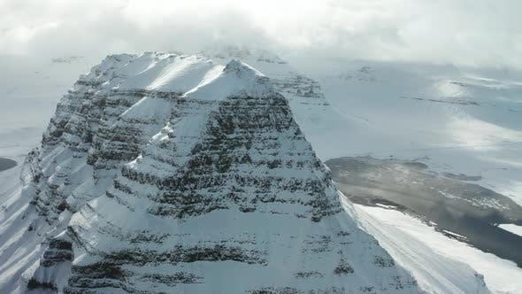 Thumbnail for Bird's-eye View of the Snowy Mount Kirkjufetl. Iceland, Winter