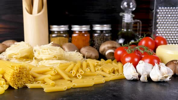 Thumbnail for Uncooked Raw Pasta in Different Variety Next To Other Fresh Ingredients