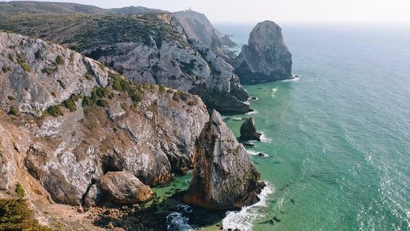Thumbnail for Aerial View of Rocky Cliff Coastline Near Praia Da Ursa Beach and Cabo Da Roca Located on Atlantic