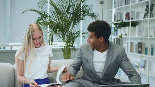 Black Man Sharing Good News with Coworkers. African-American Man Surfing Laptop and Sharing Great