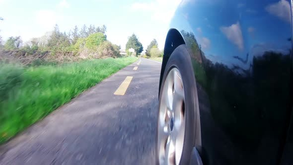 Speedy car moving on a country road 4k