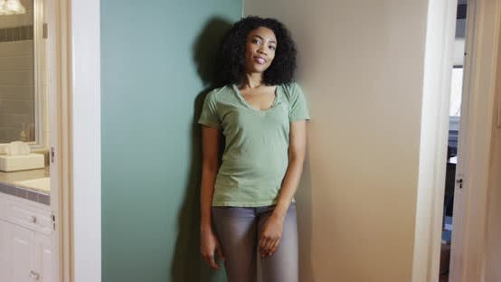 Thumbnail for Black woman standing in corner of room