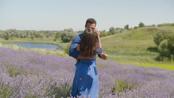 Thumbnail for Multiethnic Couple Kissing in Lavender Field