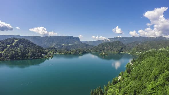 Thumbnail for Lake Surrounded by Mountains, Small Island in Middle, Cloud Reflection in Water