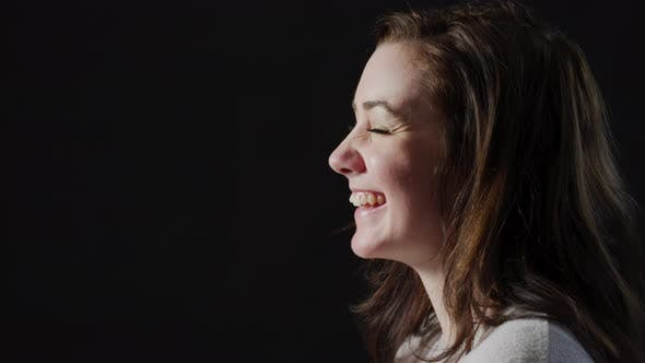Thumbnail for Side view of a woman laughing
