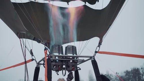 Hot Air Balloon Festival Evening Winter Burner Fills the Balloon with Warm Air Closeup