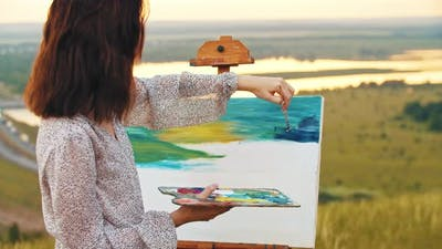 Young Woman Drawing a Painting on Nature  Drawing Blue Sky
