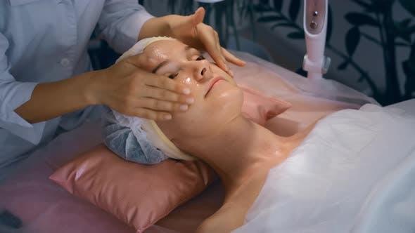 Facial Procedure At Beauty Treatment Salon