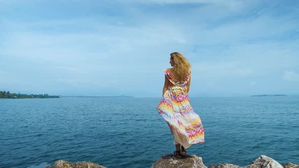 Thumbnail for Girl in a Beautiful Dress Is Standing on the Coast