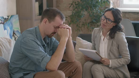Therapist Supporting Patient with Depression