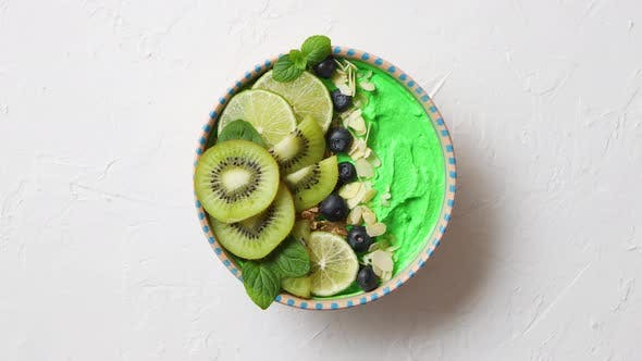 Thumbnail for Green Smoothie or Yogurt Bowl. With Fresh Kiwi, Blueberries, Lime and Almond Flakes