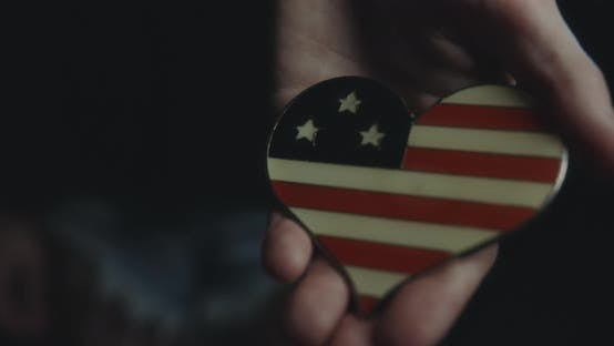 Thumbnail for Female Hand Holding A USA Flag Badge.