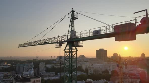 Thumbnail for Construction Crane on a Construction Site in the City at Sunrise, Kyiv, Ukraine, Aerial View