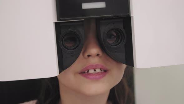 Closeup Of Little Girl Doing Eye Vision Test