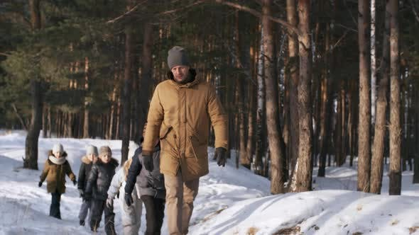 Cover Image for Father and Kids in Winter Forest